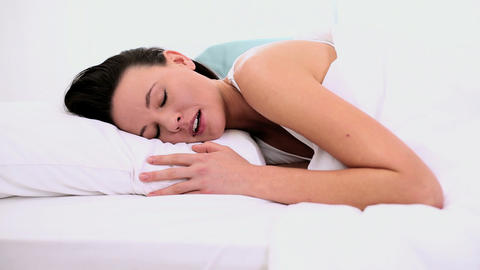 Peaceful attractive woman sleeping lying in her be Footage