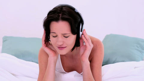 Happy enjoying woman listening with headphones to  Footage