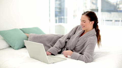 Peaceful brunette woman using her notebook wearing Footage