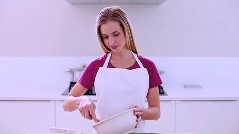 Content young woman preparing cake standing in kit Footage