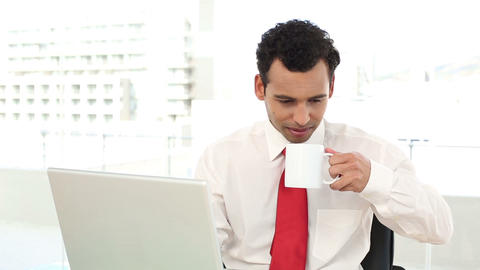Cheerful handsome businessman typing on laptop Footage