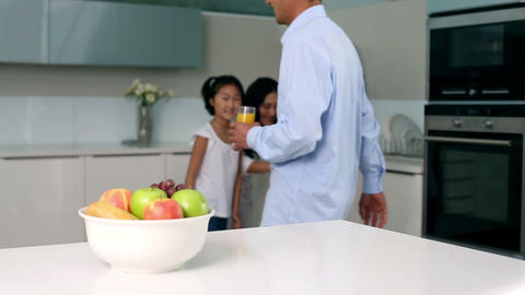Little girl taking apple out of bowl Footage