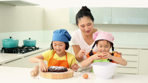 Mother and daughters baking together Footage