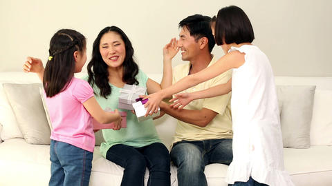 Cute family giving their mother presents Footage