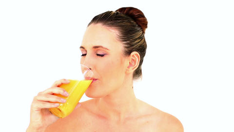Pretty woman drinking orange juice Footage