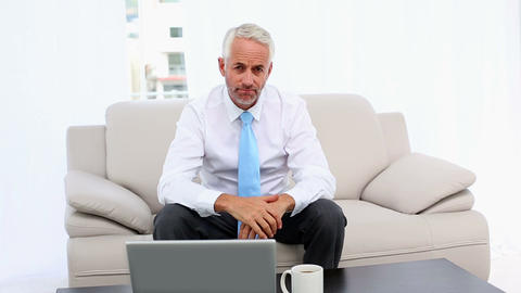 Stressed businessman looking at laptop then camera Footage