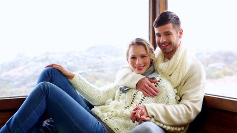 Cute couple relaxing together in their winter cabi Footage