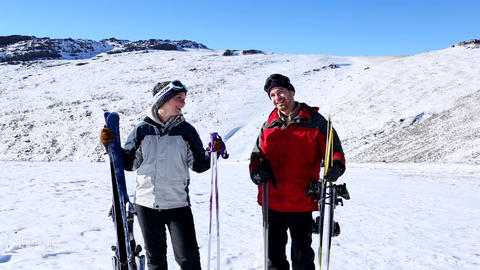 Active couple holding skis and poles Footage
