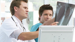 Two doctors looking at an xray Footage