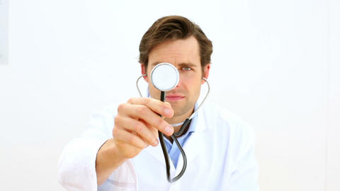 Smiling doctor holding stethoscope Footage