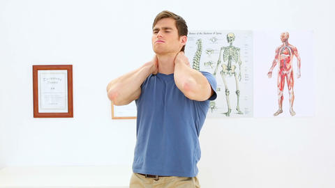 Patient stretching his back in physiotherapy offic Footage