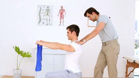 Physiotherapist checking shoulders of patient pull Footage