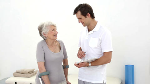 Physiotherapist talking with senior patient on cru Footage