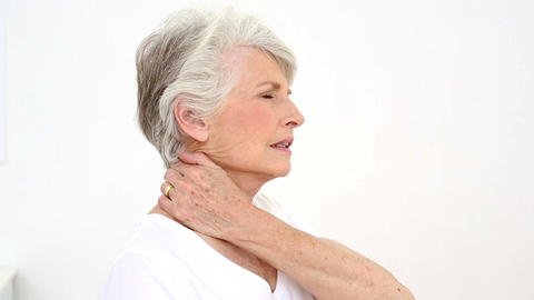 Injured patient rubbing her neck Footage