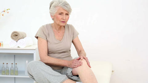 Injured patient rubbing her sore knee Footage