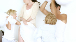 Happy family having pillow fight Footage