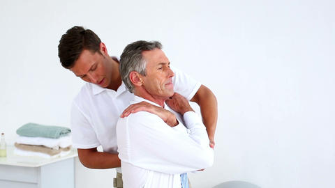 Stressed Businessman Getting His Shoulders Aligned stock footage