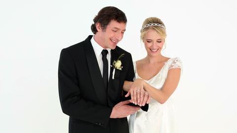 Newlyweds admiring their wedding rings Footage