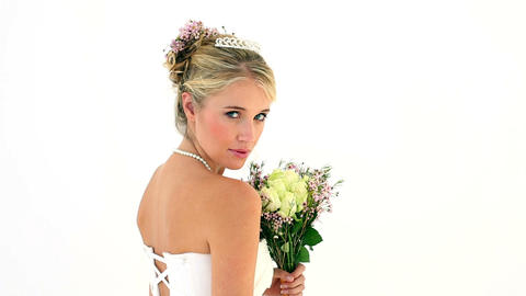 Blonde young bride turning to smile at camera Footage
