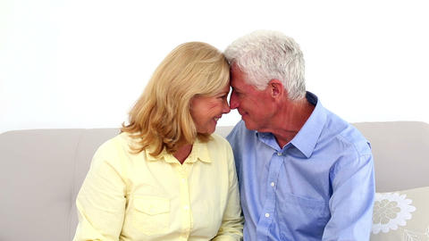 Smiling retired couple being affectionate on the c Footage