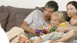 Happy family playing a video game Footage