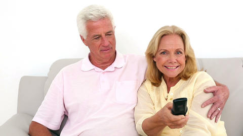 Retired couple watching television on the couch Footage