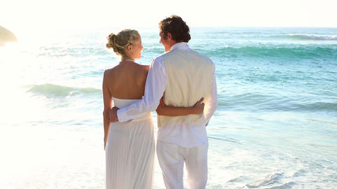 Newlyweds looking out to the sea Footage