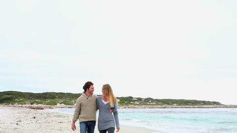 Happy couple walking on the beach Footage