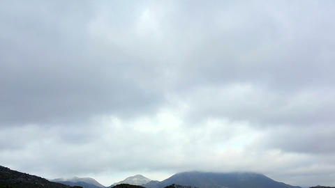 Cloudy Sky Over Mountains stock footage