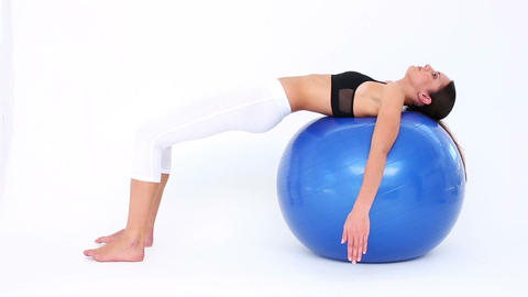 Fit Model Doing Pelvic Lifts On Blue Exercise Ball stock footage