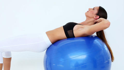 Fit model doing sit ups on exercise ball Footage