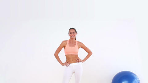 Fit model dancing and smiling at camera Footage