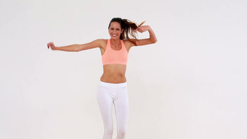 Fit pretty model dancing and smiling at camera Footage