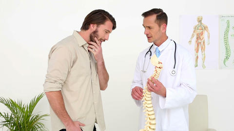 Doctor talking with his patient about a skeleton s Footage