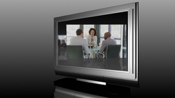 Television Screen showing Business Meetings Footage