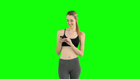 Fit model sending a text message Footage