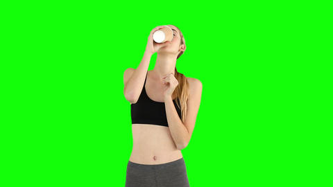 Fit model drinking from disposable cup Footage