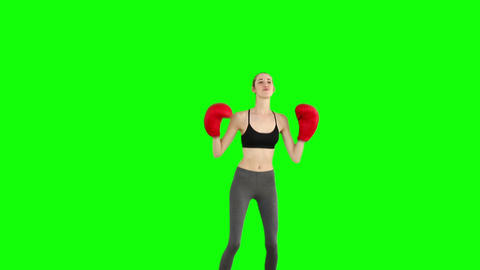 Slim model cheering with red boxing gloves Footage