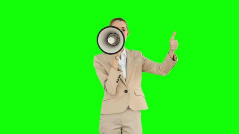 Positive businesswoman shouting through megaphone Footage