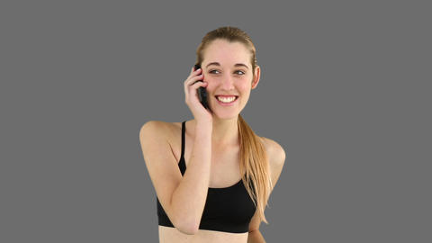Fit model answering the phone Footage