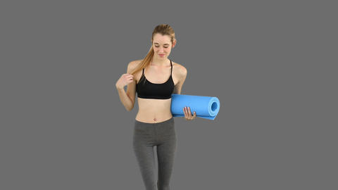 Slim model waving and holding exercise mat Footage