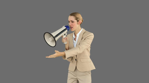 Bossy businesswoman shouting through megaphone Footage