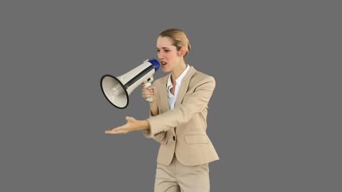 Bossy businesswoman shouting through megaphone Footage