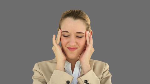 Businesswoman with a headache Footage