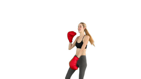 Fit model cheering with red boxing gloves Footage