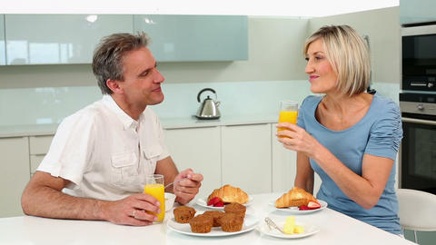 Mature couple having a romantic breakfast together Stock Video Footage