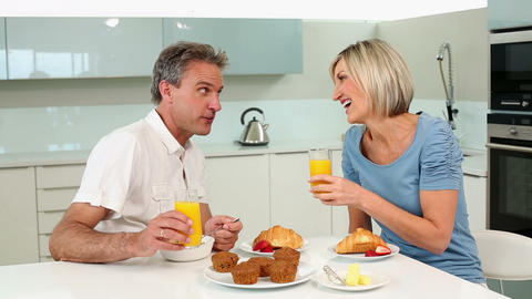 Mature couple having a romantic breakfast together Footage