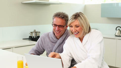 Couple using their laptop at breakfast time Footage
