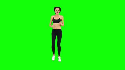 Fit brunette jogging Footage