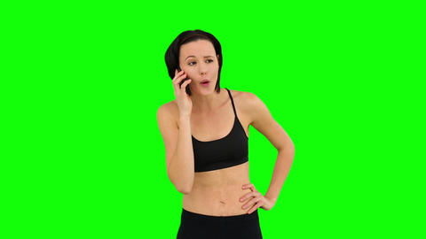 Fit brunette talking on the phone Footage